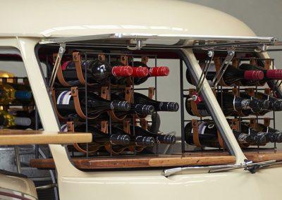 Bottles of champagne inside white branded Kombi car