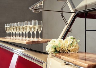 Line of Champagne glasses with yellow roses