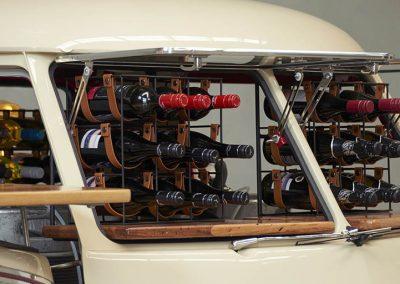 Lots of champagne horizontal bottles inside Pop up kombi red branded van with