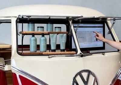 Pop Up Kombi Bottles and Computer Monitor inside Read branded Kombi Van