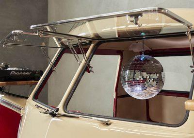 Pop Up Kombi DJ Gallery With Silver Disco Ball inside the white branded Kombi van
