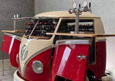 Pop up kombi gallery wine inside red branded kombi van side view