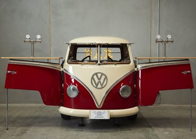 Red branded kombi van with two stands