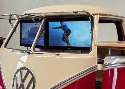 Two LCD display inside branded Kombi Red Van